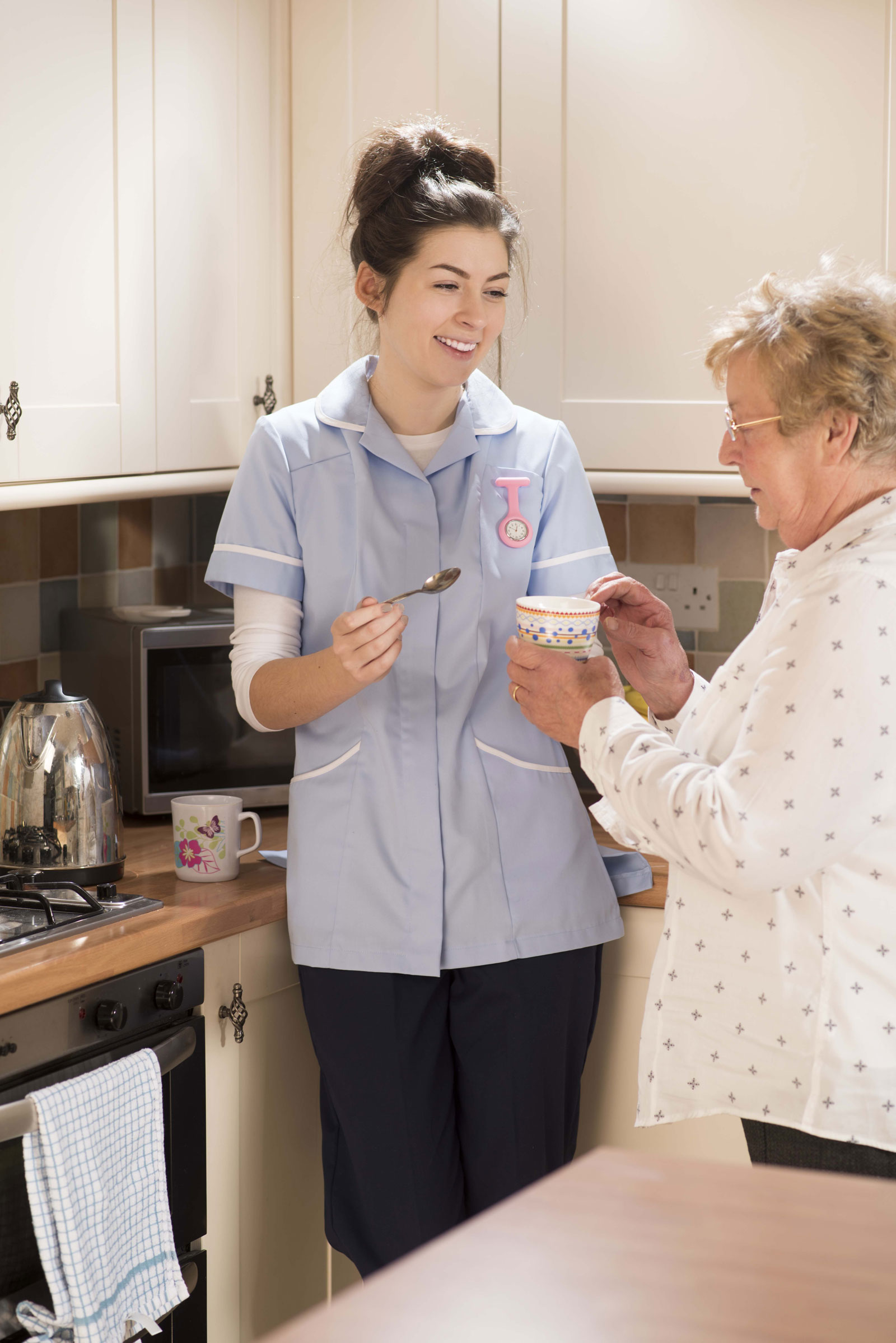 Image of careworker with eldery person